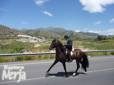 A horseman in front of the national park mountians