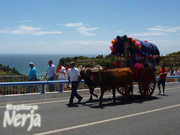 One of the decorated carts with the Mediterranean Sea in the background